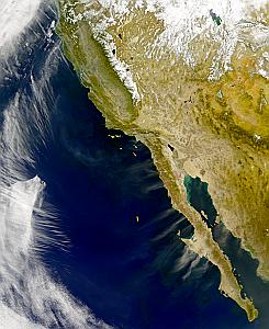 wind-borne dust and smoke from Baja